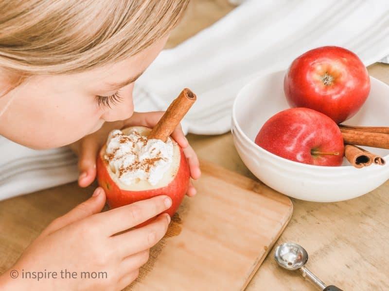 girl with carved apple mug