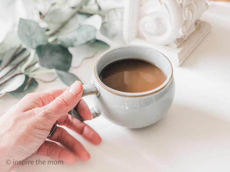 holding-coffee-cup