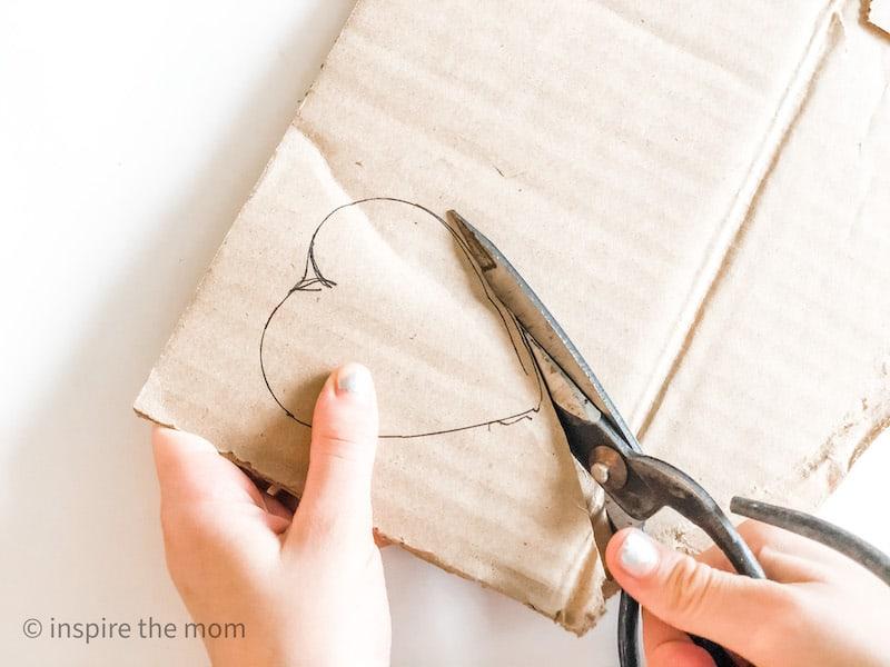 cutting a cardboard heart