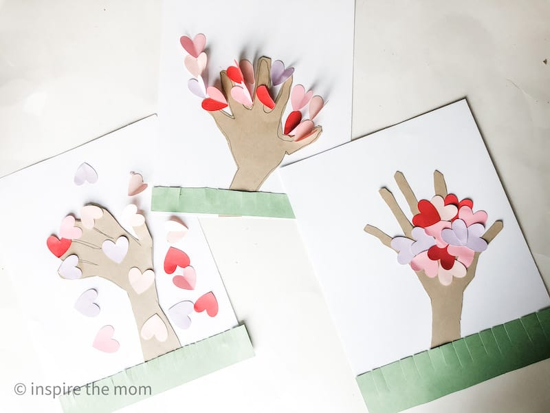 three completed handprint heart tree craft
